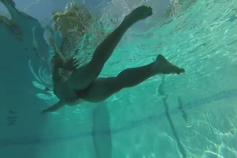 Swimming in nature's garb In Slow Motion, Including Some Underwater Dancing