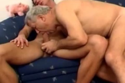 older daddy With Younger nail On daybed