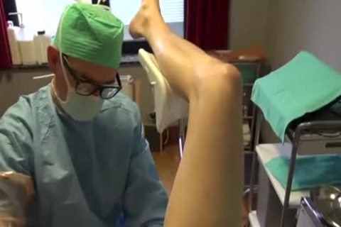 25yo Male Patient receives Fisting Initiation By Surgeon On The Examination Table.