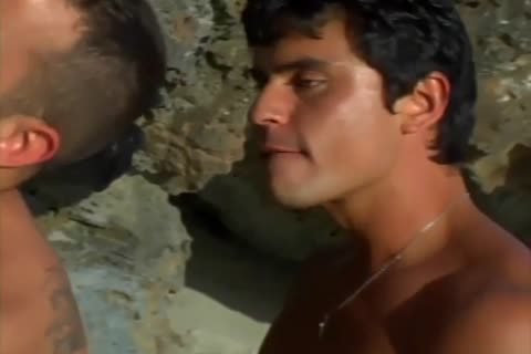 A homosexual couple Have Sex On A Beach Outside