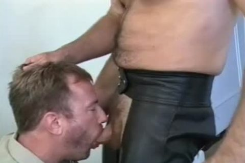 Muscly Leather Daddy receives His powerful penis Sucked