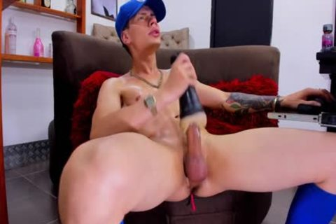 young athletic boy With Tattos Plays With Fleshjack And sperm