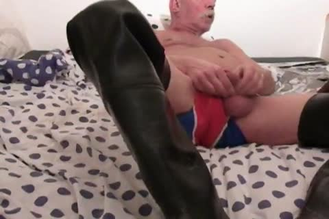 nlboots - stroking in waders on sofa